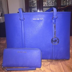 Blue Michael Kors tote with matching wallet
